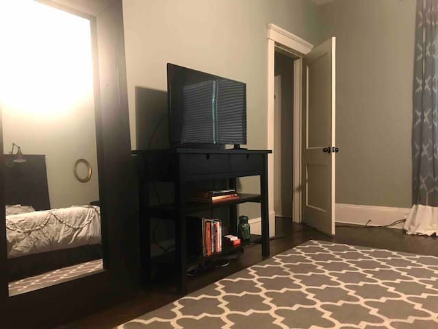 Full length mirror, large tv, books/games, and private closet for your use.