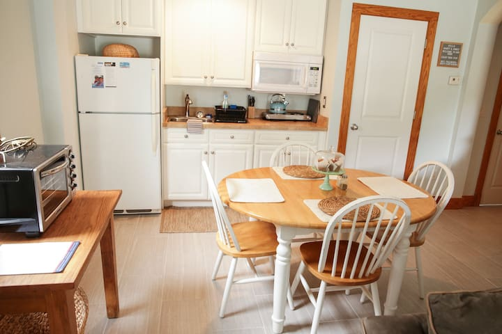 Kitchenette with refrigerator, microwave, KitchenAid toaster oven, & double hot plate.