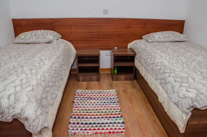 standard bedroom with either comfortable twin beds or can be converted to comfortable double bed