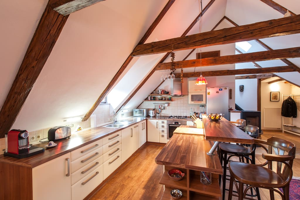 Open space kitchen under neath the 15th century truss