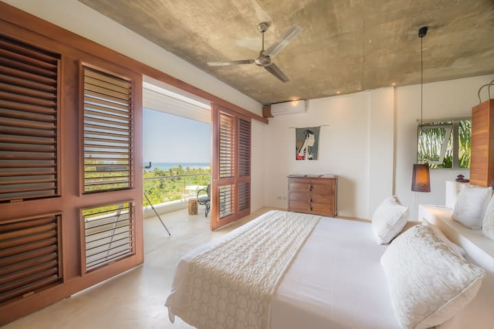 Master bedroom. Indulging relaxation in a nutshell: King size, AC, ceiling fan, electric storm shutters, en suite full bathroom, terrace and breathtaking views.