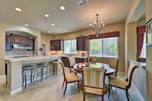 Seating is available at the kitchen table and breakfast bar.