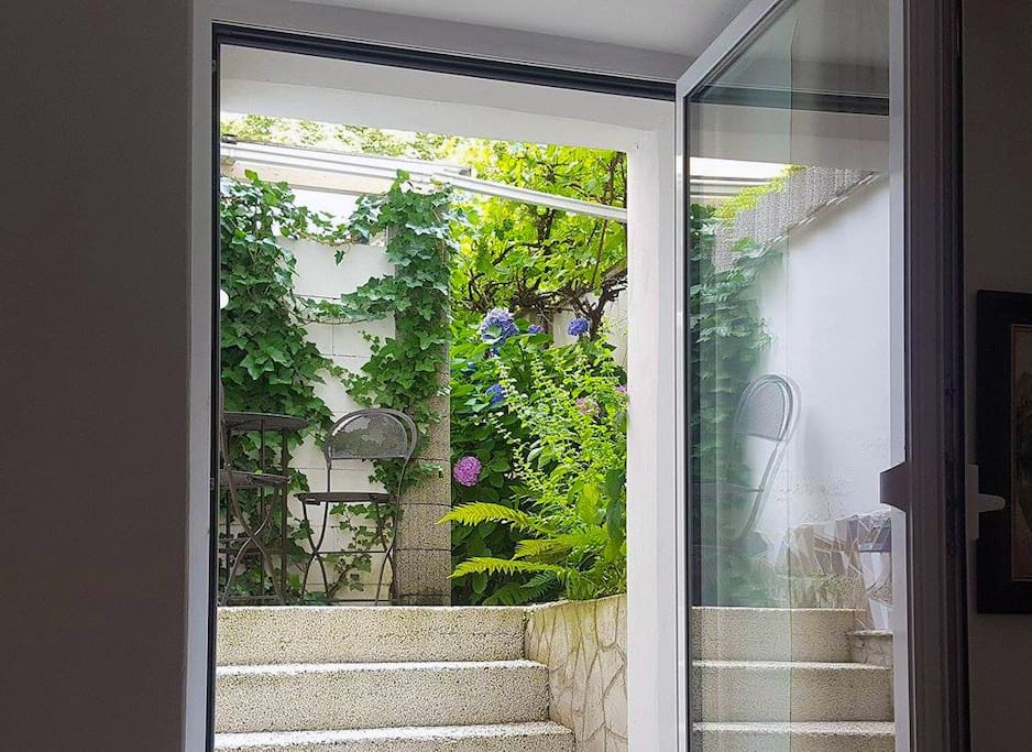 Direct exit to the courtyard and summertime!