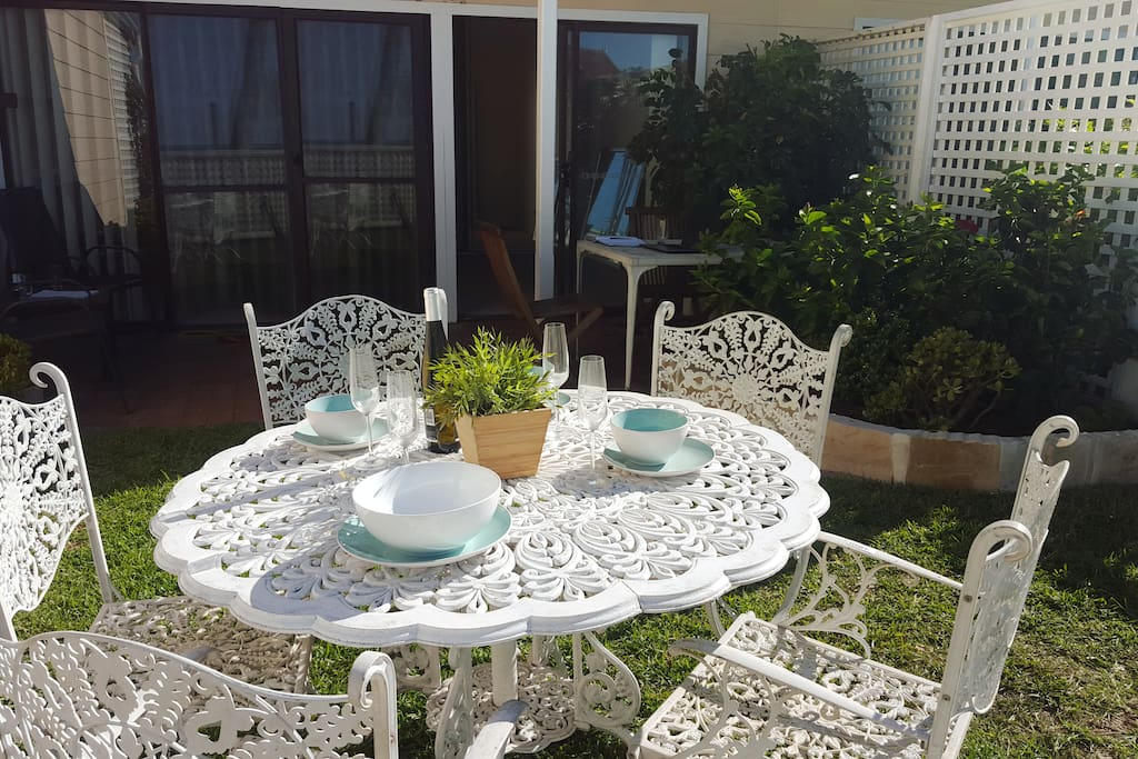 Host friends or family by the ocean in your private garden