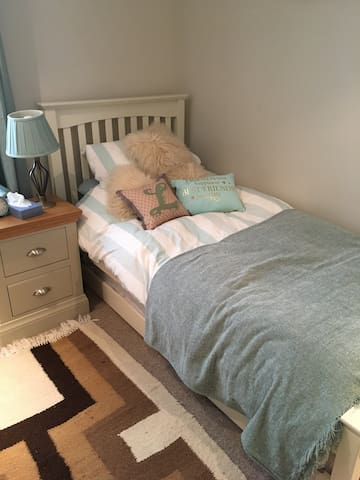 Single bed with roll away underneath