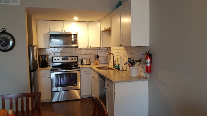 Kitchen has all appliances and is well-stocked for all your cooking needs.