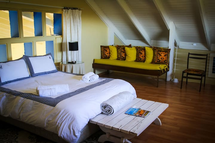This room boasts beautiful views and a relaxing spacious atmosphere.