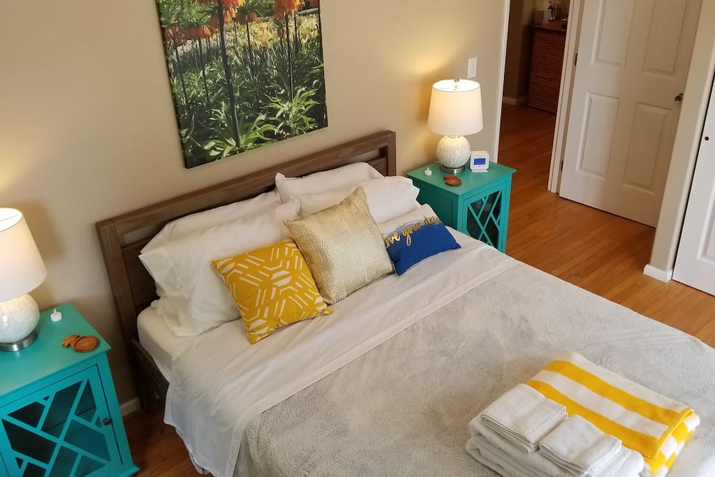 """★★★★★ Review from Shane - April 2018: """"We loved our stay at Jenn & Kristian's home in Pahoa, Hawaii. They were exceptionally helpful before we arrived. In fact, it felt like we were dealing with old friends and by the end of our stay, we were sad to leave. The space felt new, clean, well organized, spacious, and well stocked with in-house amenities. Janine absolutely adored the decor and colour scheme and we really appreciated the comfortable, quality beds and linens. The attention to detail was very thoughtful including the welcome package with local treats, snorkelling and beach gear, refrigerated condiments, personal care items, guide books for the area, recommendations for things to see and do, etc. Everything was well thought out and made our stay that much better. The yard is an exquisite collection of luscious jungle foliage including various bamboo, fruit trees, and exotic scented and brightly coloured beautiful tropical flowers - exactly what you would dream of in a Hawaiian paradise garden. We spent every morning enjoying our breakfast out on the lanai, rain or shine, taking in the views of the greenery and watching the local wildlife. Highlights for us included cracking a fresh coconut that fell from one of the trees, the cute and comedic geckos, bird watching with a red cardinal as our favourite visitor, and the hypnotic sounds of the jungle that soothed us into deep sleeps at night. The neighborhood is amazing, with picture perfect postcard views and phenomenal gardens everywhere you look, a real heaven on Earth. It is quiet and peaceful with wildlife aplenty, the furthest thing from the hustle and bustle of city life and the perfect location to refresh and find your centre. The property is within walkable proximity to the Kehena Black Sand Beach, which was great as it took only 5 minutes out the door to having black sand under our feet. Everyone we met in the area was warm and friendly, welcoming, helpful, and you really felt like you were safe and sec"""