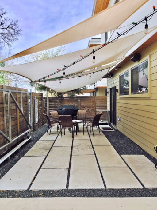 Great hangout space with sunshades and gas grill.