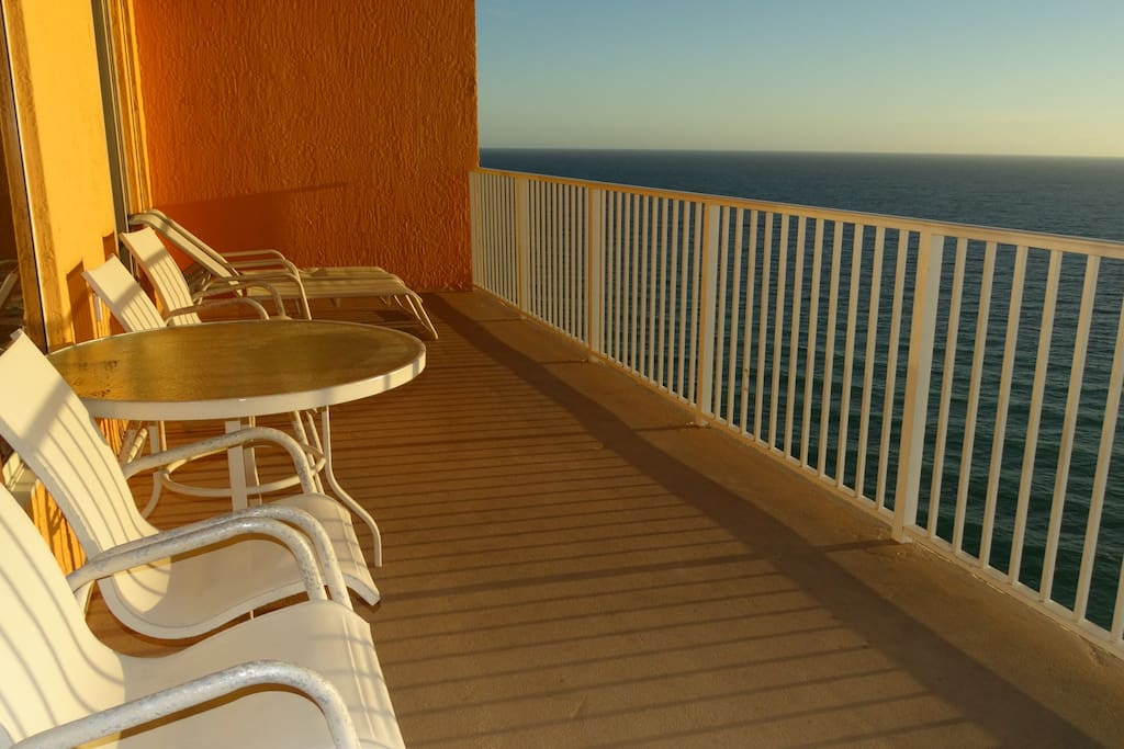 Balcony view with patio table and plenty of seating