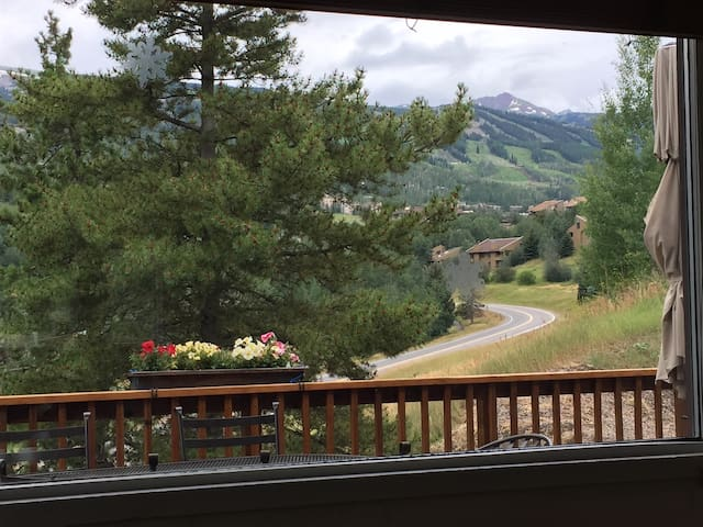 From our balcony, looking at Snowmass Ski Resort! With binoculars, you can keep track of your family & friends skiing!