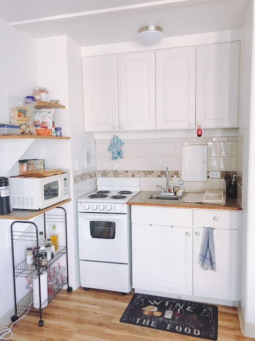 Full size fridge/freezer.  Kitchen with pots/pans and cooking accessories. Dishes and spices for cooking simple meals. Microwave oven, oven with 4 burners/oven to cook your meals. Toaster as well.