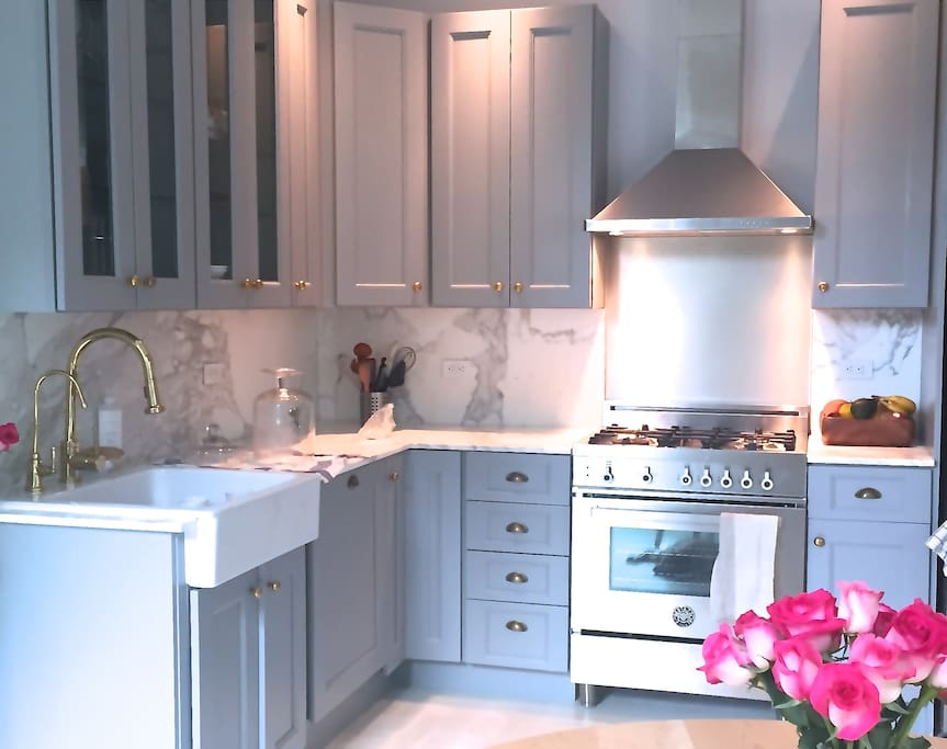 Freshly renovated gourmet kitchen w calacatta marble + Bertazonni range
