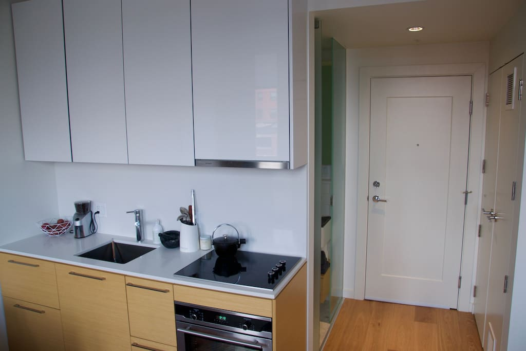 Kitchen, entryway and entrance to washroom