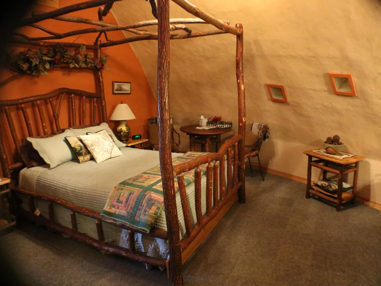 The Pheasant room has a queen bed on a frame that was made for this themed rustic room.