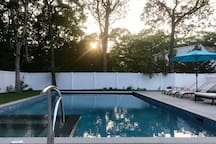 The pool - 20x40 foot saltwater gunite swimming pool -- at sunset. It's a relaxing place to unwind and cool off.