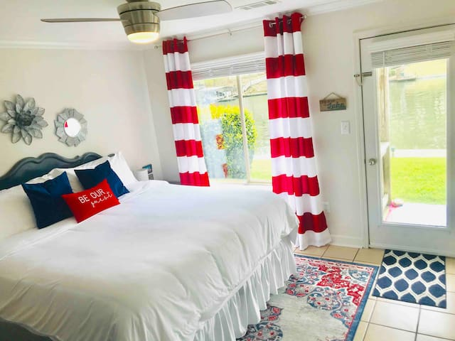 The master suite boasts a king size bed with fabulous linens and duvet for luxurious comfort, a picture window overlooking the lake, it's own private door leading out to the porch, & a 40 inch flat screen with swivel mount for easy viewing from bed!