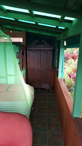 To provide respite from the tropic storms wind, all the open air windows are fitted with heavy duty weather resistant drapes that can be adjusted by hand.