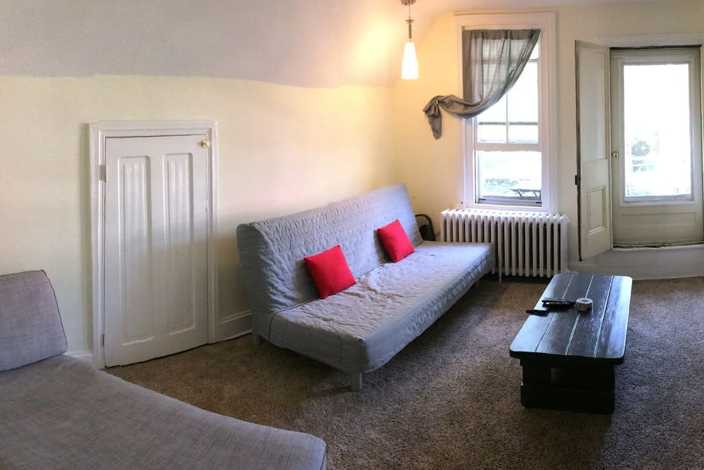 Front room has Queen-Size futon that could sleep two comfortably and a Chaise-Lounge which could sleep one. Room is equipped with small fridge, TV and small collapsable table with stool. Folds up easily and does not take up a lot of space.