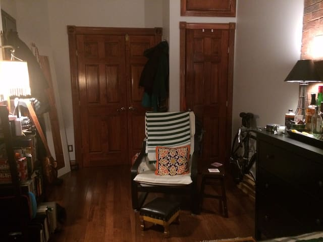 View from desk toward doorway to living room. Private entrance on left, closet on right.
