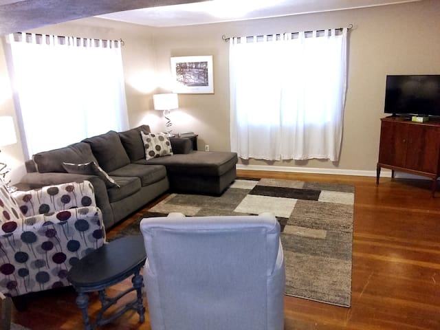 Livingroom.   Wood floors.  Room for people to gather in the family room and adjoining dining area.