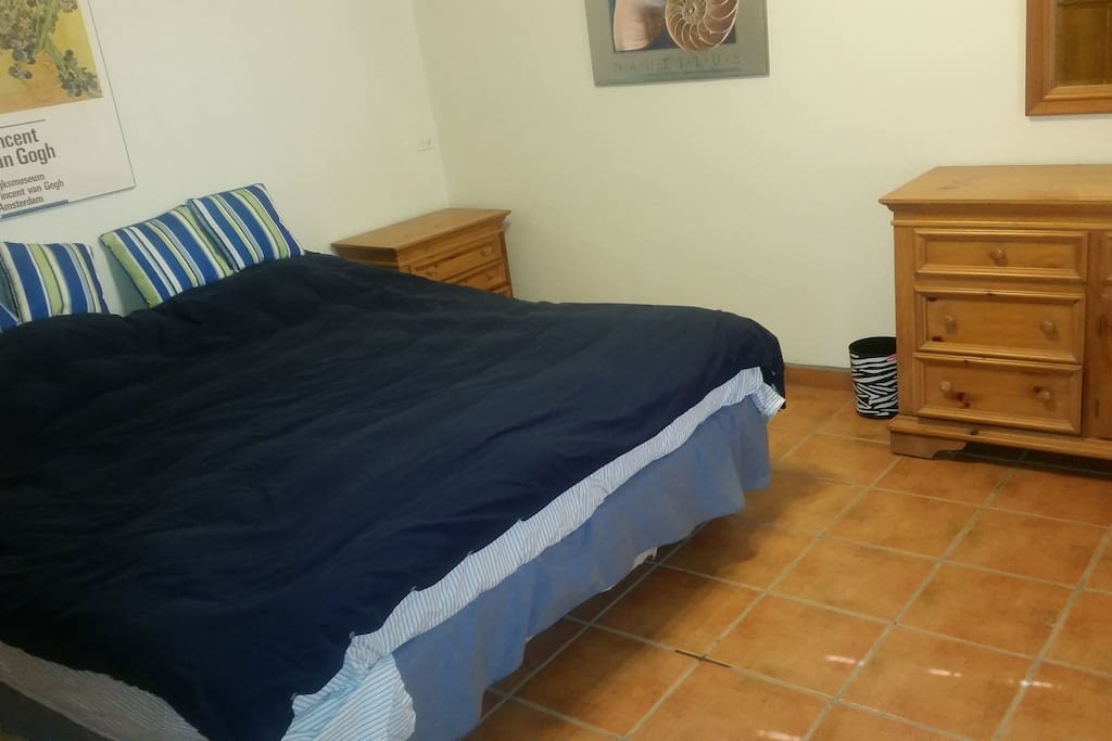 One of the kingsize beds in the master bedroom