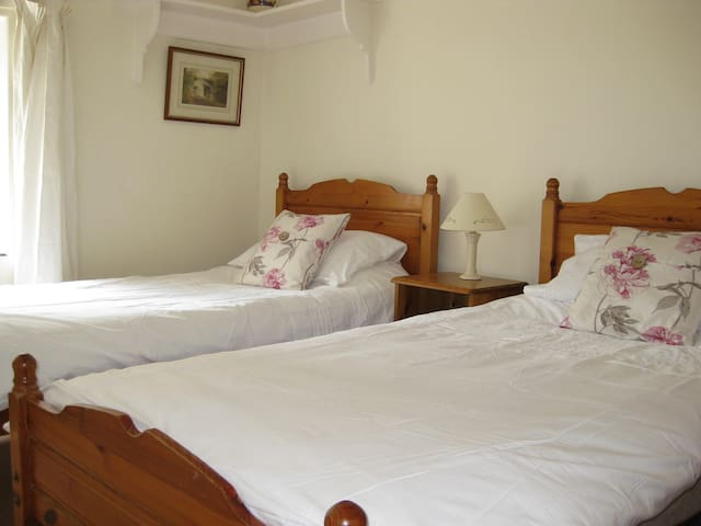 Twin bedroom with chest of drawers