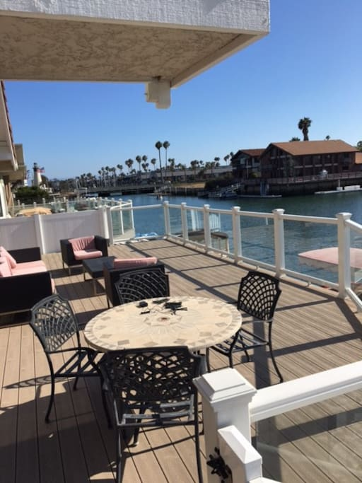 patio sits right over the water.. see the kayakers, boaters pass by. or get lucky and see our local seals