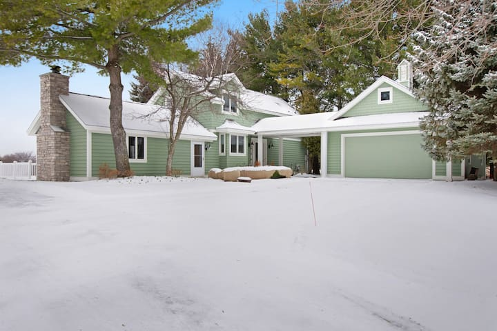 Family-friendly home with expansive deck, large lawn & access to clubhouse!