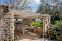 The pergola with the external kitchen provided also with a washing machine.