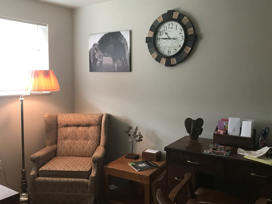 Office with antique desk and finishings and natural light! (All animals in decor are endangered and info on how you could help is around entire apt.)