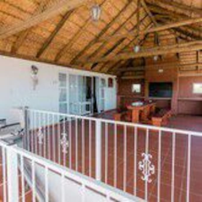 covered balcony with stunning seaview and braai with outdoor dining area