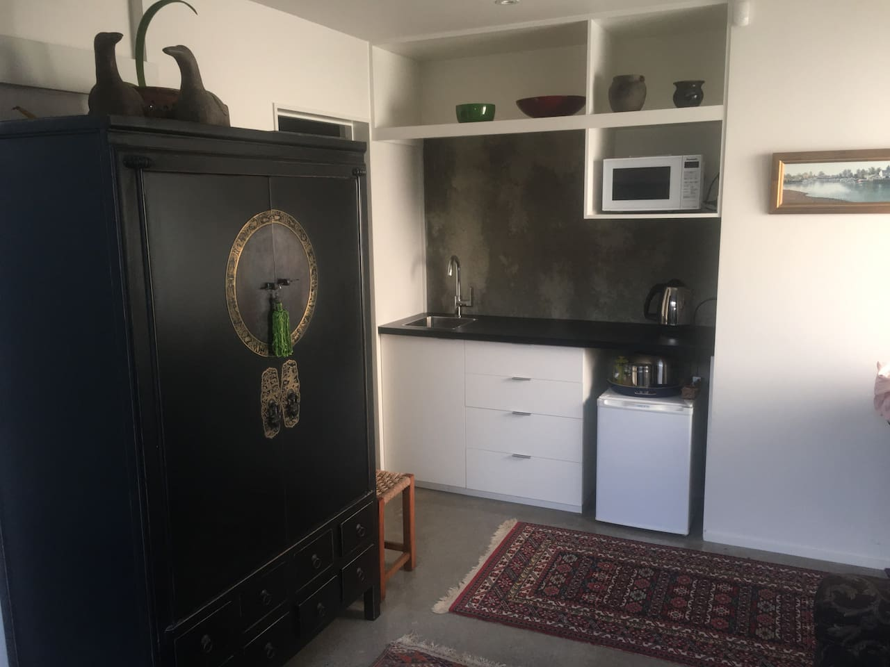 Kitchenette including fridge, microwave and a jug all for your own use.