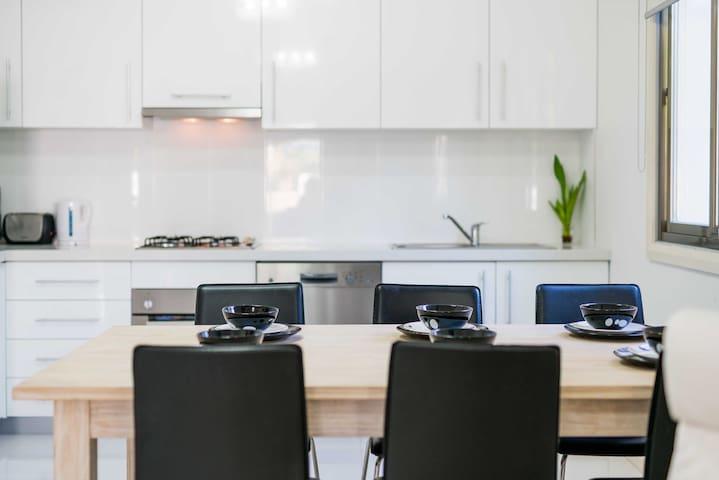 Bright, modern Bayside apartment
