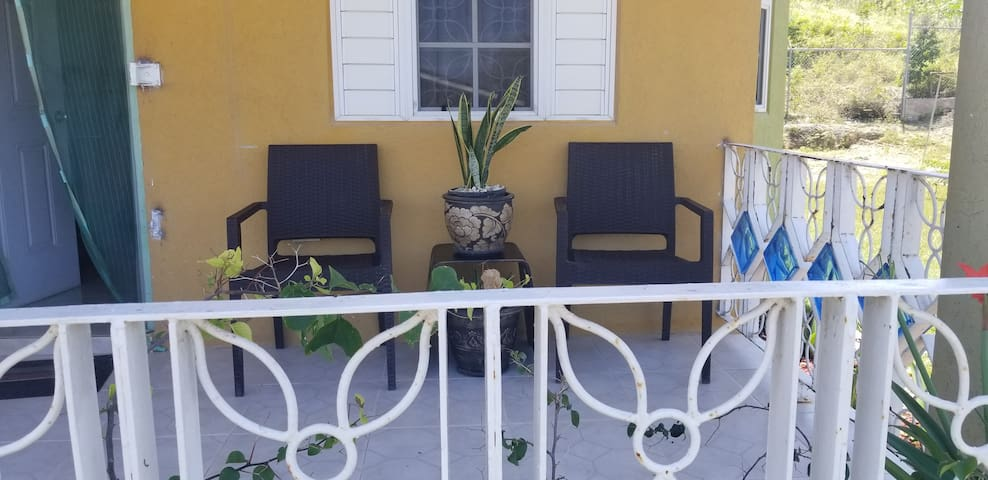 Secure Jamaican  Getaway with private  Back Porch