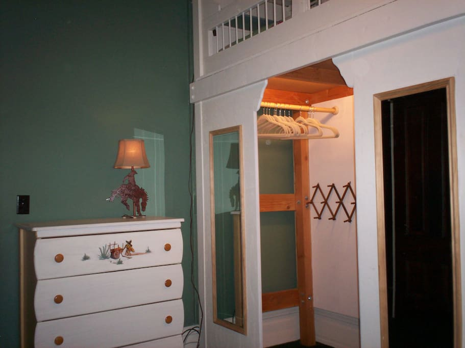 Closet and dresser in bedroom
