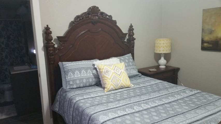 Master bedroom with queen size bed and attached full bath.