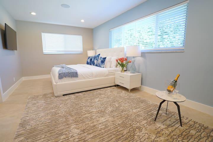 Spacious Private Bedroom Suite One Features King Bed + Samsung 4K Smart Streaming TV + Sofa + Walk-In Closet + En Suite Bathroom...