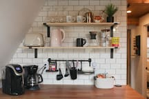 Fully stocked kitchen with everything you need to make coffee, tea, and more.
