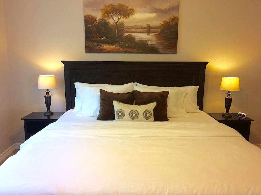 """""""Clean, bright, and comfy house!""""  Master bedroom with King bed."""