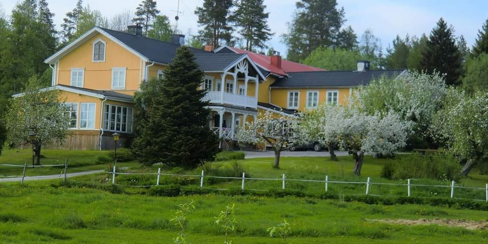 Skånestugan, unic living, a house inside old barn