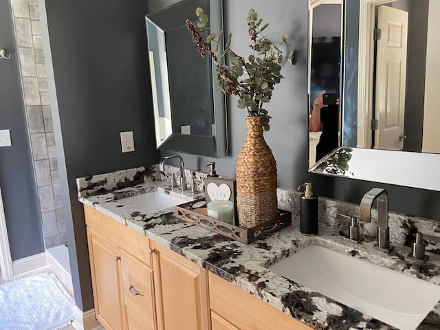 Main double vanity bathroom with water closet and jacuzzi tub.