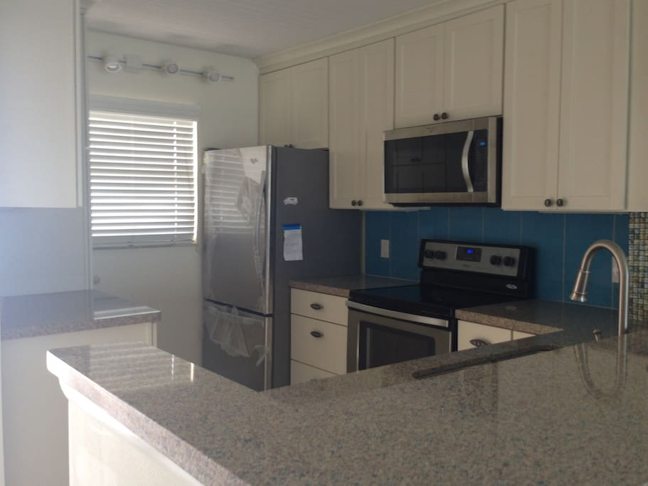 bright & cheery kitchen, all new appliances & cabinets