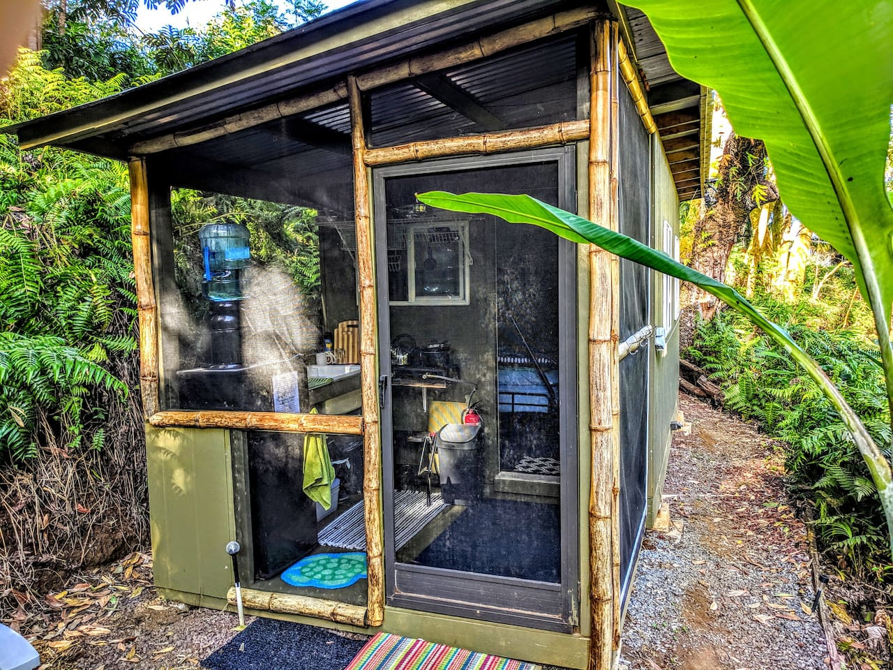 Listen to the peaceful sounds of the river and rainforest in this tiny cabin