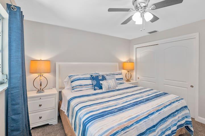"Bedroom #2: King bed w/ pillow top mattress, closet, ceiling fan & 43"" smart TV."