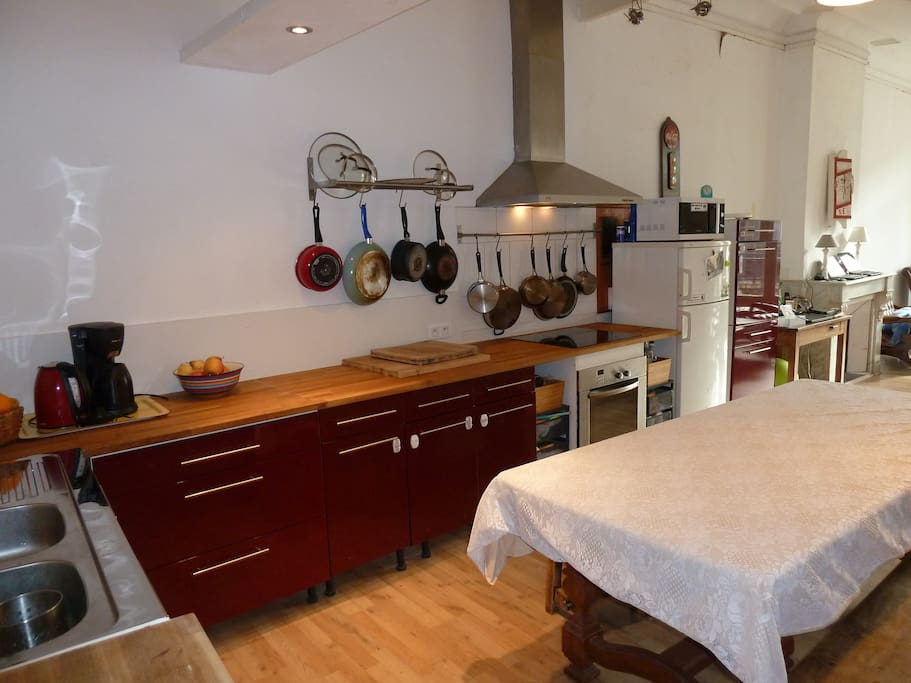 Our newly-renovated kitchen gives a large space to make and enjoy meals, and has opened up the kitchen into the living room