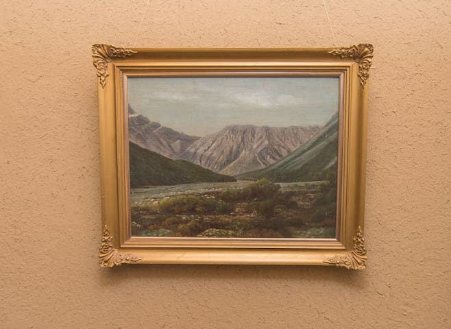 Admire the original art works hung around the home, painted by local South Canterbury artists
