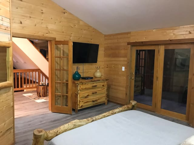 View from the master bedroom looking out towards the loft and the private balcony. Breckenridge, Colorado. Vacation Home Rental.