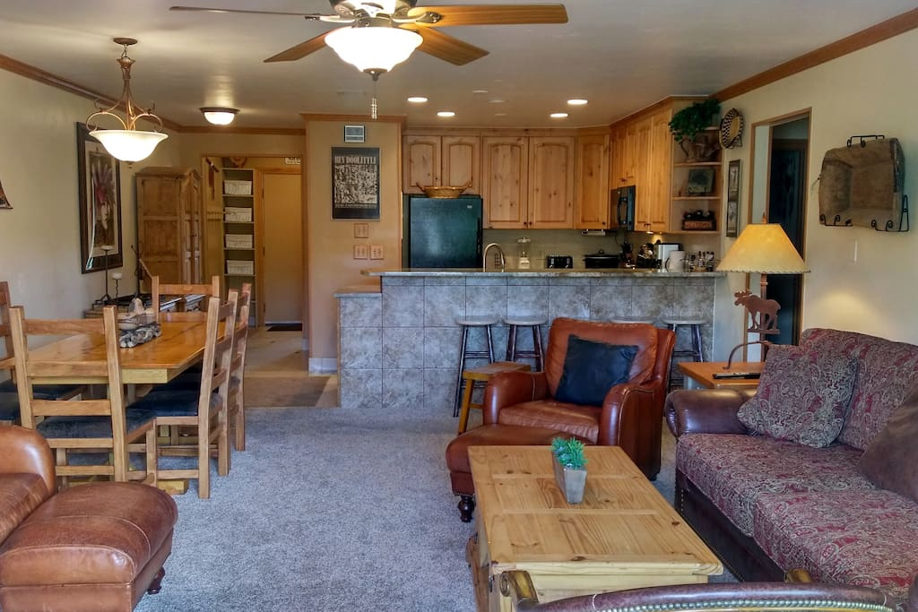 Beaver Creek West Condo B-3 living room with sofa bed, gas fireplace and dining table