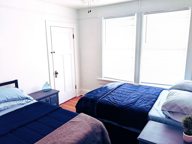 First bedroom with two full beds.